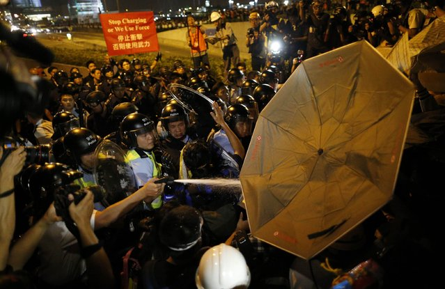 Police use pepper spray during clashes with pro-democracy protesters at a rally close to the chief executive office in Hong Kong, November 30, 2014. (Photo by Tyrone Siu/Reuters)