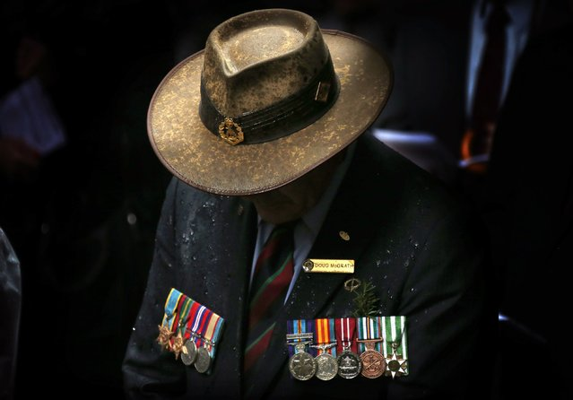 A veteran wearing service medals bows his head during a remembrance service on ANZAC Day in central Sydney, in this April 25, 2014 file photo. (Photo by David Gray/Reuters)