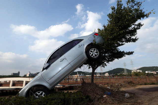 A car damaged by typhoon Chaba is seen in Ulsan, South Korea, October 6, 2016. (Photo by Kim Yong-tae/Reuters/Yonhap)