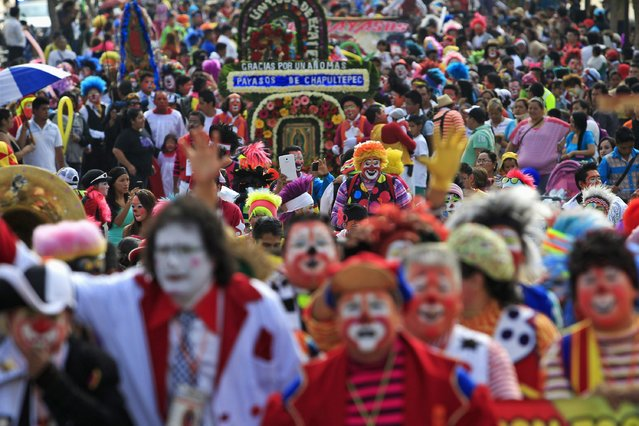 Clowns make their annual pilgrimage to the Basilica of Our Lady Guadalupe to pay homage to the Virgin of Guadalupe in Mexico City December 16, 2014. (Photo by Carlos Jasso/Reuters)