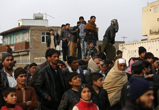 Afghans gather at the site of a suicide attack in Kabul January 5, 2015. (Photo by Mohammad Ismail/Reuters)