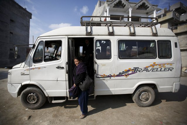 A woman steps off from a women-only bus in Kathmandu January 6, 2015. (Photo by Navesh Chitrakar/Reuters)