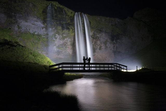 These stunning pictures of beautiful Icelandic waterfalls will take your breath away. The mesmerizing shots show the striking waterfalls set against the night sky and the hypnotic green glow of the northern lights, as well as the picturesque Icelandic scenery and stunning sunrises. (Photo by Arnar Kristjansson/Caters News)