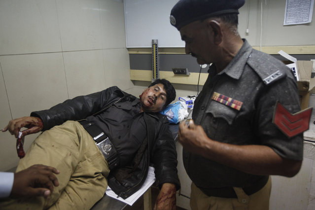 A policeman who suffered wounds from stone pelting during a protest against satirical French weekly Charlie Hebdo receives medical attention at a hospital in Karachi January 16, 2015. (Photo by Athar Hussain/Reuters)