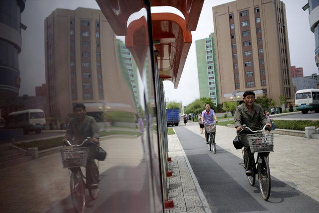 A man cycles along Mirae Scientists Street in Pyongyang, North Korea, Saturday, June 16, 2018. (Photo by Dita Alangkara/AP Photo)