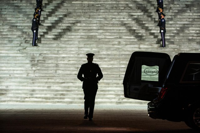 The remains of Capitol Police Officer Brian Sicknick, who died from injuries sustained during the January 6th insurrection at the U.S. Capitol, is carried up the East Front steps prior to lying in honor in the Rotunda of the U.S. Capitol in Washington, DC, U.S. February 02, 2021. (Photo by Jim Lo Scalzo/Pool via Reuters)