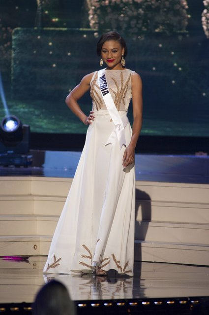Queen Celestine Osem, Miss Nigeria 2014 competes on stage in her evening gown during the Miss Universe Preliminary Show in Miami, Florida in this January 21, 2015 handout photo. (Photo by Reuters/Miss Universe Organization)