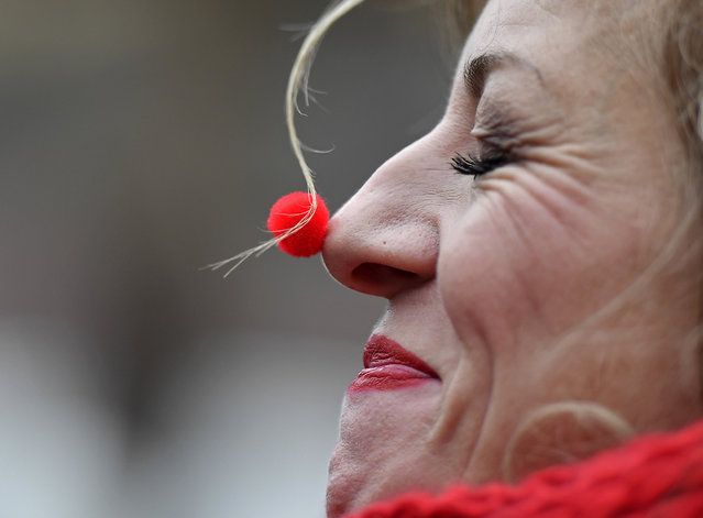 A reveller with a tiny red nose celebrates the start of the carnival season in the streets of Cologne, Germany, on Friday, November 11, 2016. (Photo by Martin Meissner/AP Photo)