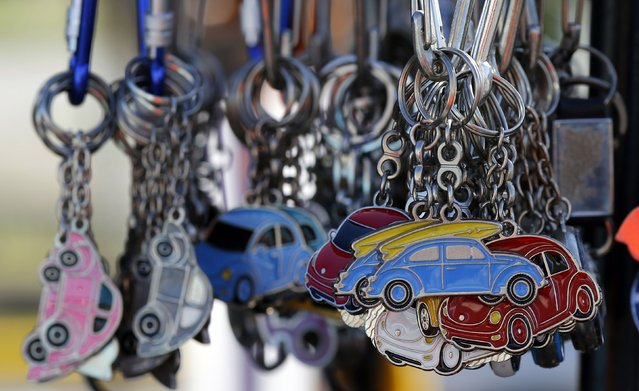 Volkswagen Beetle keychains are displayed during a Volkswagen Beetle owners' meeting in Sao Bernardo do Campo January 25, 2015. (Photo by Paulo Whitaker/Reuters)