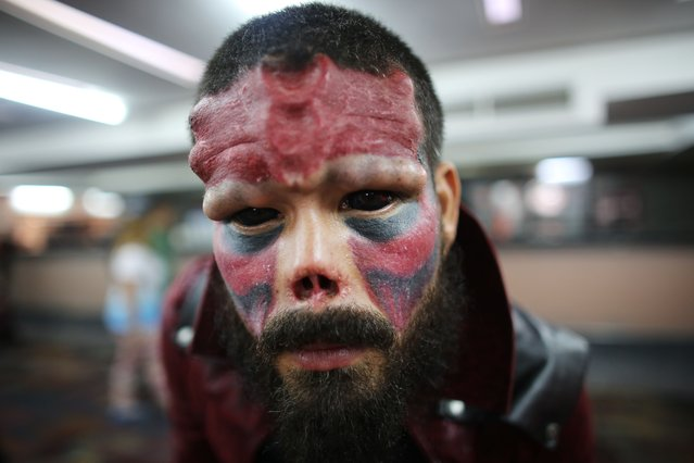 A Venezuelan man known as Red Skull poses for a portrait during the annual Venezuela Tattoo International Expo in Caracas, Venezuela, Thursday, January 29, 2015. (Photo by Ariana Cubillos/AP Photo)