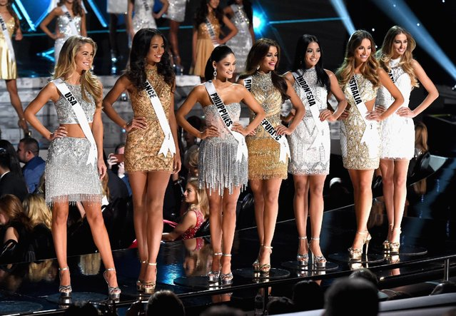 The top 15 finalists (L-R) Miss USA 2015, Olivia Jordan, Miss France 2015, Flora Coquerel, Miss Philippines 2015, Pia Alonzo Wurtzbach, Miss Dominican Republic 2015, Clarissa Molina, Miss Indonesia 2015, Anindya Kusuma Putri, Miss Australia 2015, Monika Radulovic, Miss Brazil 2015, Marthina Brandt, compete during the 2015 Miss Universe Pageant at The Axis at Planet Hollywood Resort & Casino on December 20, 2015 in Las Vegas, Nevada. (Photo by Ethan Miller/Getty Images)