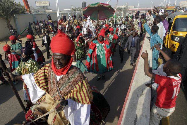 People cheer as new Emir of Kano Muhamadu Sanusi II (C) rides on a horse to his coronation in Kano, Kano State, February 7, 2015. (Photo by Afolabi Sotunde/Reuters)