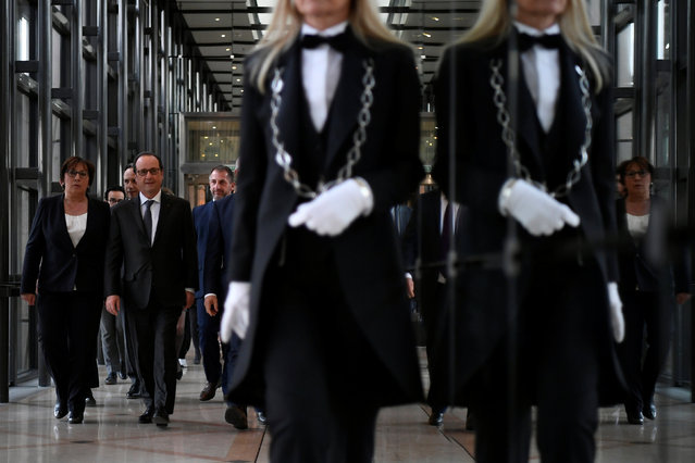 French President Francois Hollande (2ndL) arrives to deliver a speech on social contracts of employment at the end of the Conference on the social impact investment at the Ministry of Economy in Paris, France, November 24, 2016. (Photo by Lionel Bonaventure/Reuters)