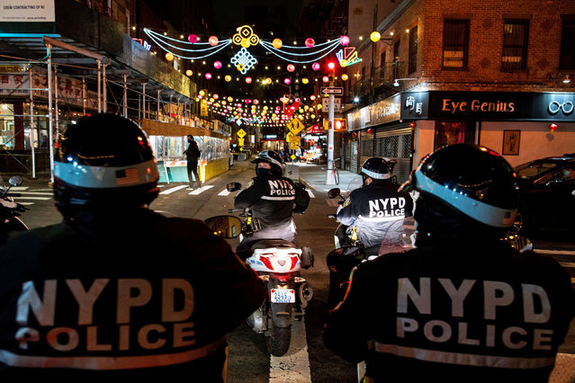 NYPD officers patrol the streets of Chinatown in the Manhattan borough of New York City, New York, U.S., March 25, 2021. (Photo by Eduardo Munoz/Reuters)