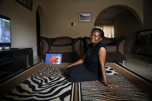 Fashion designer Omobola Omowunmi, 43, an ethnic Yoruba Christian woman, poses for a portrait in the living room of her home in Oregun district in Nigeria's commercial capital Lagos February 1, 2015. (Photo by Akintunde Akinleye/Reuters)