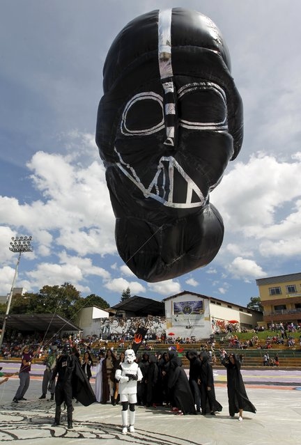 A balloon depicting Darth Vader from the Star Wars movies is seen at the 15th Solar Balloon Festival in Envigado, Colombia December 31, 2015. (Photo by Fredy Builes/Reuters)