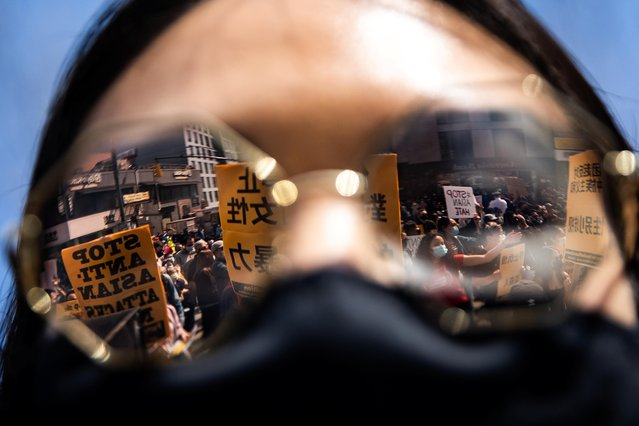 Protesters are reflected on a sunglasses during a national day of action to combat anti-Asian violence in Queens, New York, U.S., March 27, 2021. (Photo by Jeenah Moon/Reuters)