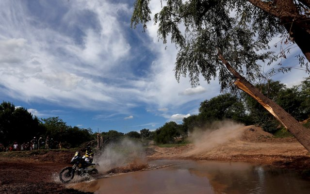 Ruben Faria of Portugal rides his Husqvarna motorcycle through the water during the Buenos Aires-Rosario prologue stage of Dakar Rally 2016 in Arrecifes, Argentina, January 2, 2016. (Photo by Marcos Brindicci/Reuters)