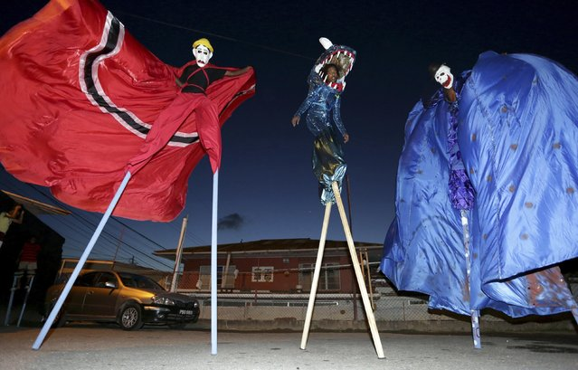 Members of the Keylemanjahro School of Arts and Culture practise walking on stilts to parade as Moko Jumbies in their base yard at Cocorite, just west of the capital Port-of-Spain, on February 12, 2015. (Photo by Andrea De Silva/Reuters)