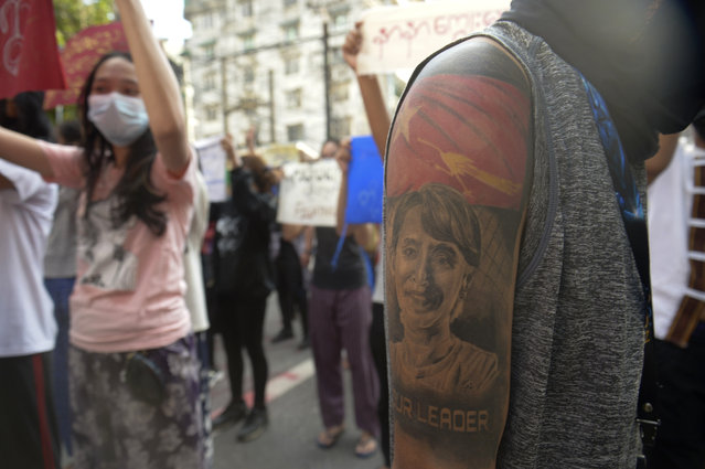 A protester with an image of ousted Myanmar leader Aung San Suu Kyi on the arm joins anti-coup protest march in Yangon, Myanmar, Saturday, April 10, 2021. Security forces in Myanmar cracked down heavily again on anti-coup protesters Friday even as the military downplayed reports of state violence. (Photo by AP Photo/Stringer)
