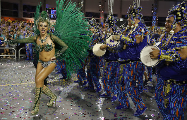 A dancer from the Vila Maria samba school performs during a carnival parade in Sao Paulo, Brazil, Saturday, February 14, 2015. (Photo by Andre Penner/AP Photo)
