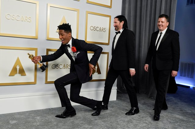 """(From L) US musician Jon Batiste, US musician Trent Reznor and English musician Atticus Ross, winners of the award for Original Score for """"Soul"""", pose in the press room at the Oscars on April 25, 2021, at Union Station in Los Angeles. (Photo by Chris Pizzello/Pool via AFP Photo)"""