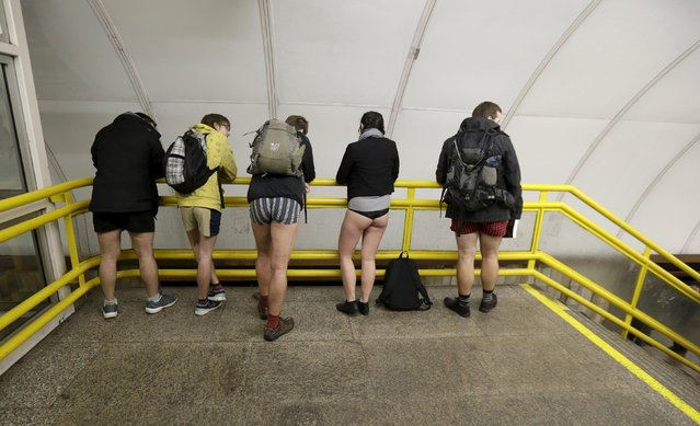 """Passengers not wearing pants wait for a subway train during the """"No Pants Subway Ride"""" in Prague, Czech Republic, January 10, 2016. (Photo by David W. Cerny/Reuters)"""