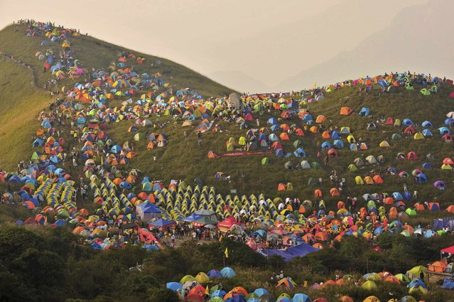 Numerous tents are seen during the 2013 International Camping Festival in Mount Wugongshan of Pingxiang, Jiangxi province, on September 17, 2013. (Photo by Reuters)