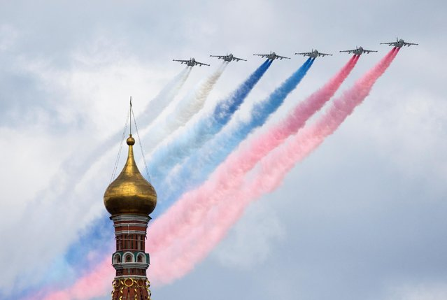 Su-25 jet fighters release smoke in the colours of the Russian state flag over Red Square during a flypast rehearsal ahead of a parade on Victory Day, which marks the anniversary of the victory over Nazi Germany in World War Two, in Moscow, Russia on May 5, 2021. (Photo by Shamil Zhumatov/Reuters)