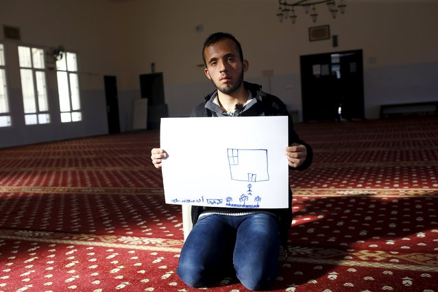 Syrian refugee Ahmet Abdulkadir, 17, shows his drawing of home as he sits in a mosque in Nizip refugee camp in Gaziantep province, Turkey, December 13, 2015. (Photo by Umit Bektas/Reuters)