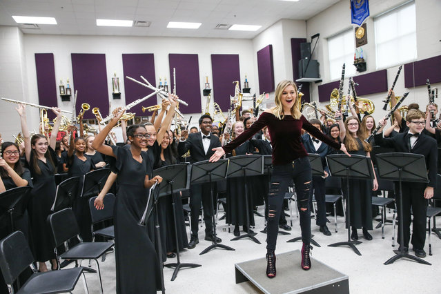 """Singer-songwriter Kelsea Ballerini speaks to the Oliver Middle School wind Ensemble during the CMA Foundation's Announcement of a One Million dollar donation to the Metro Nashville public schools """"Music makes us"""" progam at Oliver Middle School on December 6, 2016 in Nashville, Tennessee. (Photo by Terry Wyatt/Getty Images)"""