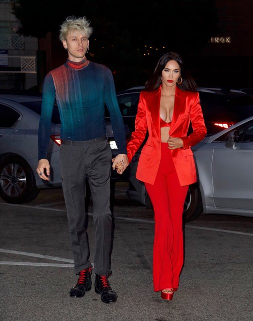 American actress and model Megan Fox nearly busts out of red silk bra as she celebrates 35th birthday with boyfriend Machine Gun Kelly in Santa Monica, California on May 15, 2021. Megan showed off her amazing figure as she was the center of attention during her birthday celebrations on Saturday. (Photo by Splash News and Pictures)