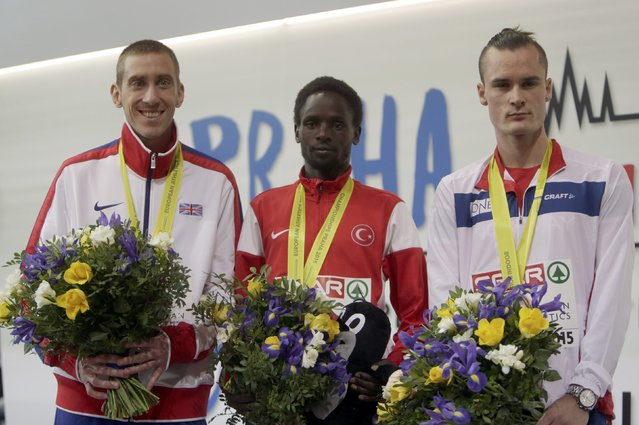Winner Ali Kaya of Turkey, second placed Emanuel Lee of Britain (L) and third placed Henrik Ingebritsen of Norway (R) celebrate on the podium at the medal ceremony for the men's 3000 metres during the European Indoor Championships in Prague March 8, 2015. REUTERS/David W Cerny (CZECH REPUBLIC  - Tags: SPORT ATHLETICS)