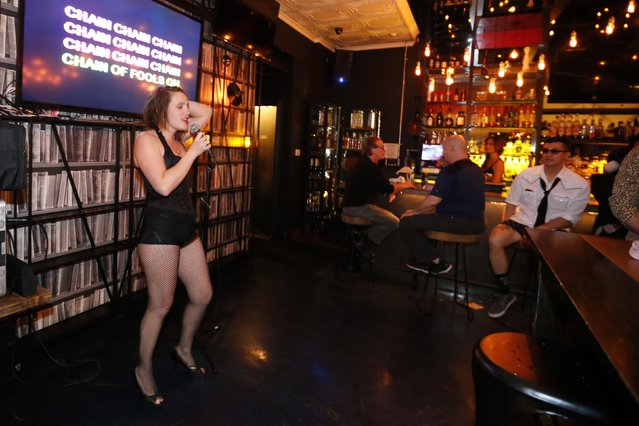 Rose Shawhan, 32, sings at the first annual Underwear Karaoke, an event that pairs two common fears: being seen in your underwear and singing in public, in Los Angeles, California March 12, 2015. (Photo by Lucy Nicholson/Reuters)
