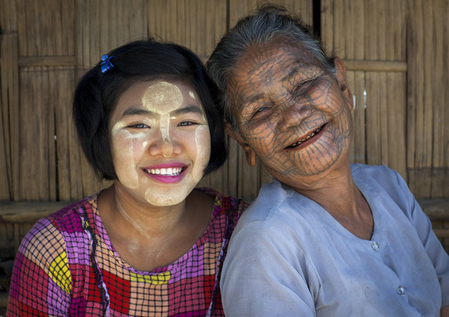 A woman from the Chinn tribe who inhabit the Mrauk U region. The design is famous for looking like a spiders web, in February, 2015, in Myanmar, Burma. (Photo by Eric Lafforgue/Barcroft Media)
