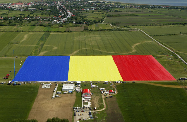 An aerial view of Romania's national flag during a Guinness World Record attempt for the world's biggest national flag in Clinceni, near Bucharest May 27, 2013.  The flag, measuring 349.4 per 226.9 meters, established a new Guinness World Record, according to the organisation's officials. (Photo by Bogdan Cristel/Reuters)