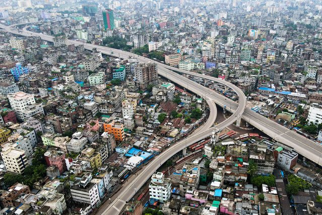 This aerial photo taken on July 1, 2021, shows empty streets in Dhaka as the country went into a strict Covid-19 Coronavirus lockdown, with the army and police ordered to stop people leaving their homes except for emergencies or to buy essentials. (Photo by Munir Uz Zaman/AFP Photo)