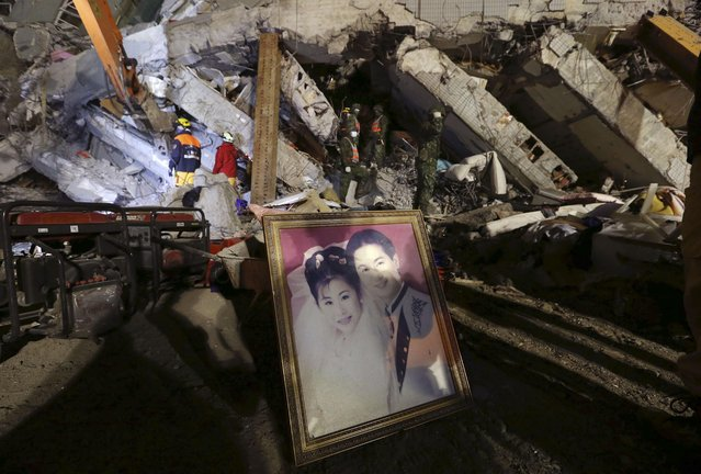 A recovered wedding portrait is propped up at the search and rescue staging area of a collapsed building complex in Tainan, Taiwan, Monday, February 8, 2016.  More than 100 people are believed to still be under the debris in a powerful quake that struck on Saturday, Feb. 6, during the most important family holiday in the Chinese calendar — the Lunar New Year. (Photo by AP Photo)