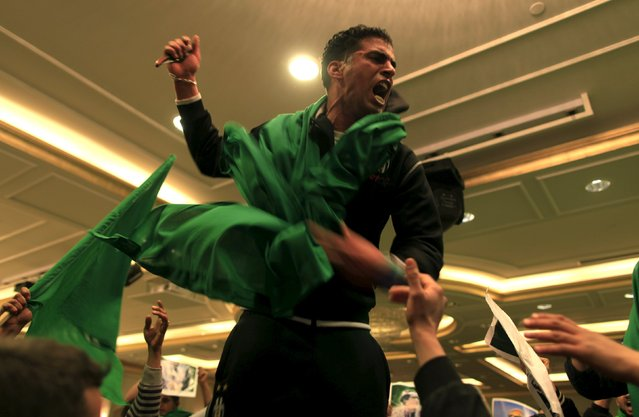 A supporter of Libya's leader Muammar Gaddafi chants anti-U.S slogans during a protest in Tripoli March 18, 2011. (Photo by Ahmed Jadallah/Reuters)