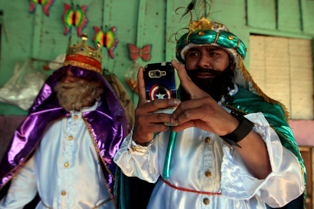 A man dressed as one of the Three Wise Man takes a photo with his mobile phone before the start of the traditional Epiphany parade in Masaya, Nicaragua January 6, 2017. (Photo by Oswaldo Rivas/Reuters)