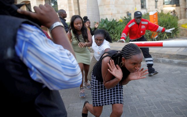 People run as they are evacuated at the scene where explosions and gunshots were heard at the Dusit hotel compound, in Nairobi, Kenya on January 15, 2019. (Photo by Thomas Mukoya/Reuters)