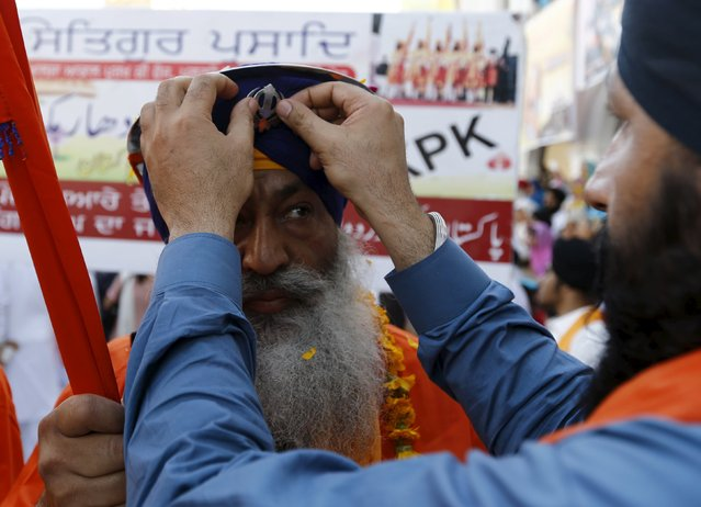 Sikh devotees prepare as they participate in the Baisakhi festival at Panja Sahib shrine in Hassan Abdel April 13, 2015. (Photo by Caren Firouz/Reuters)