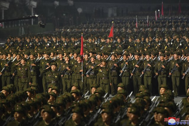 In this photo provided by the North Korean government, North Korean soldiers parade during a celebration of the nation's 73rd anniversary that was overseen by leader Kim Jong Un, at Kim Il Sung Square in Pyongyang, North Korea, early Thursday, September 9, 2021. (Photo by KCNA via KNS/AFP Photo/Stringer)