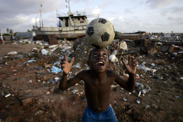 An Angolan youth plays soccer in the streets of the capital Luanda, January 30, 2010. (Photo by Rafael Marchante/Reuters)