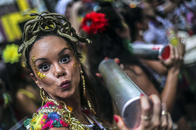 "A reveler attends the ""Volta, Alice"" celebrations before Rio Carnival, in Rio de Janeiro, Brazil, 17 February 2019. The Carnival in Rio de Janeiro runs from 02 to 09 March 2019. (Photo by António Lacerda/EPA/EFE)"