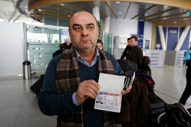Fuad Sharef Suleman shows his USA visa to the media after returning to Iraq from Egypt, where he was prevented from boarding a plane to the U.S., following U.S. President Donald Trump's decision to temporarily bar travellers from seven countries, including Iraq, at Erbil International Airport, Iraq, January 29, 2017. (Photo by Ahmed Saad/Reuters)