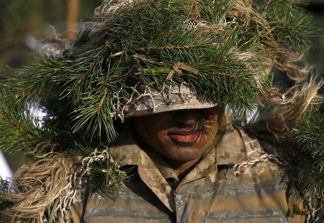 U.S. soldier attends the inauguration ceremony of bilateral military training between U.S. and Polish troops in Zagan, Poland, January 30, 2017. (Photo by Kacper Pempel/Reuters)
