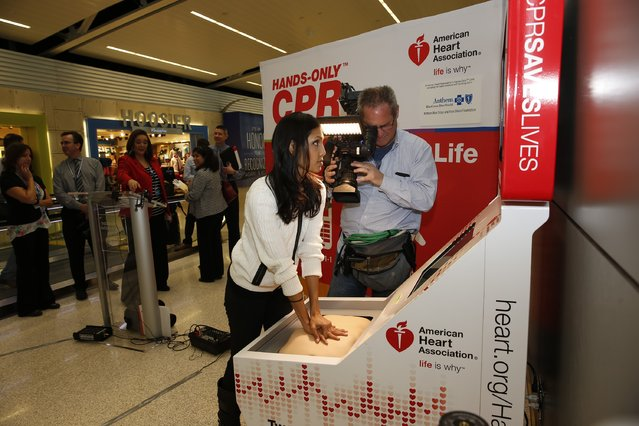 Reporter Melissa Mahadeo learns how to perform Hands-On CPR after the unveiling of the American Heart Association and Anthem Blue Cross and Blue Shield in Indiana Hands-Only CPR Training Kiosk at Indianapolis International Airport on March 10, 2016 in Indianapolis, Indiana. (Photo by Michael Hickey/Getty Images for American Heart Association)