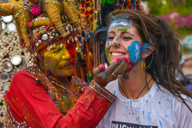 Foreign tourist celebrates Holi in Pushkar, India on March 19, 2019. (Photo by Shaukat Ahmed/Pacific Press via ZUMA Wire/Rex Features/Shutterstock)