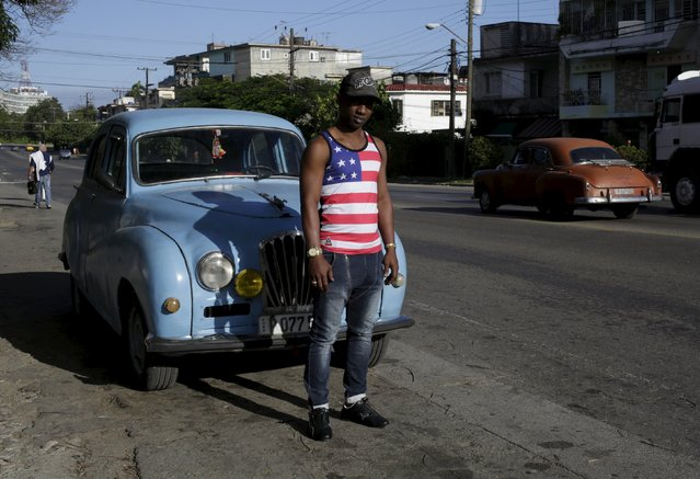 Yosuan, 26, wearing a shirt with the U.S flag, stands on a street in Havana February 22, 2016. (Photo by Enrique de la Osa/Reuters)
